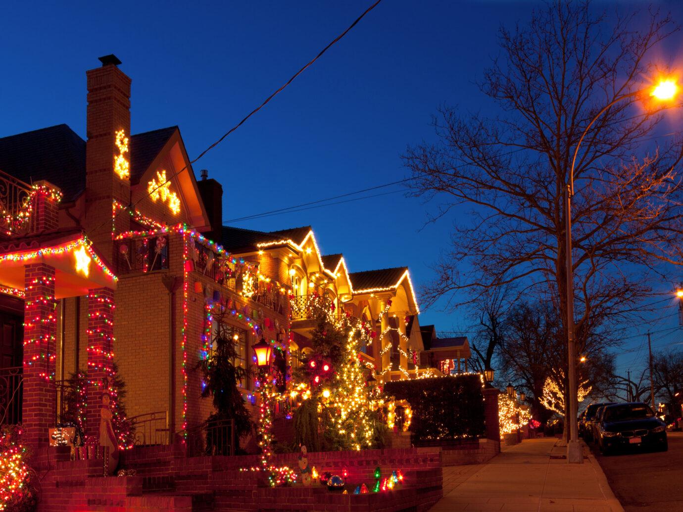 Homes with Christmas Lights in Dyker Heights neighbourhood of Brooklyn, New York, USA.