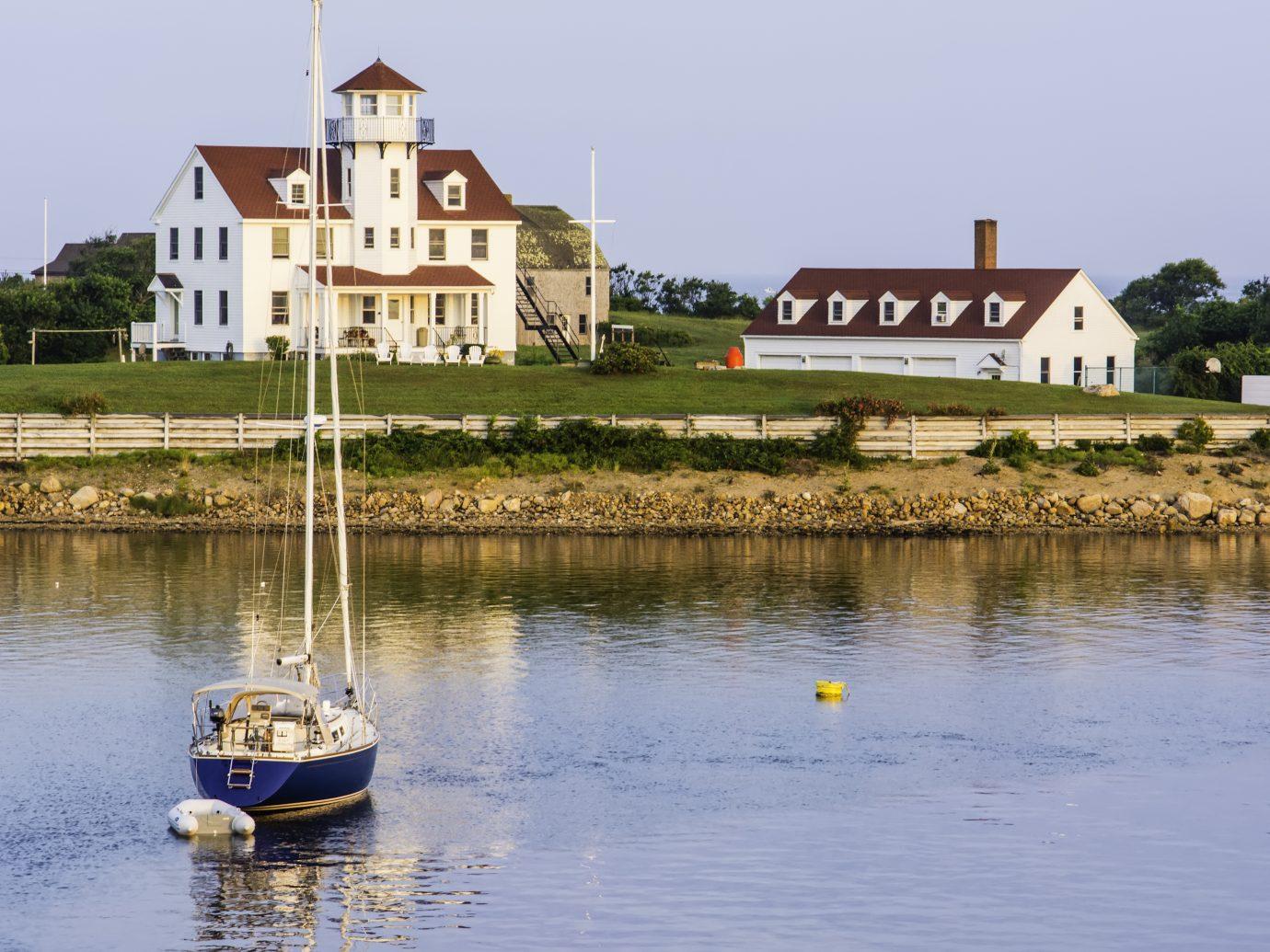Yacht anchored near Coast Guard station at Block Island, Rhode Island, USA, shortly after sunrise