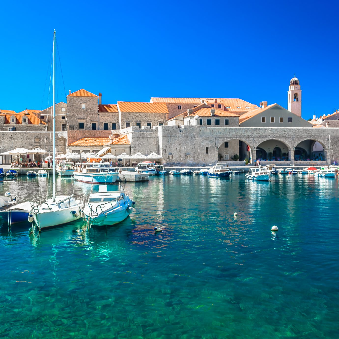 Waterfront view at sea port in Dubrovnik old town, famous european tourist resort in Europe, Southern Croatia.