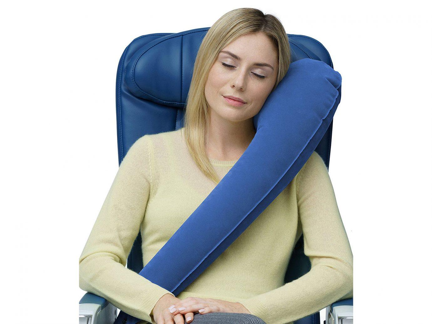 Woman resting against Blue Travelrest Ultimate Travel Pillow