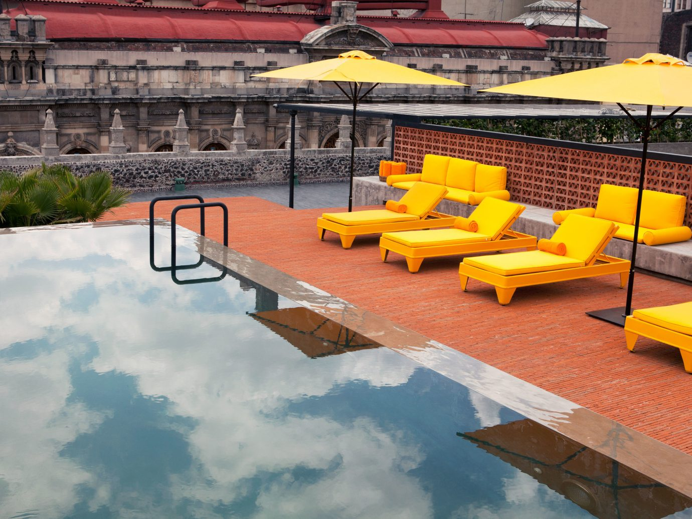 Hotels table outdoor leisure chair swimming pool yellow backyard Resort estate Playground outdoor structure
