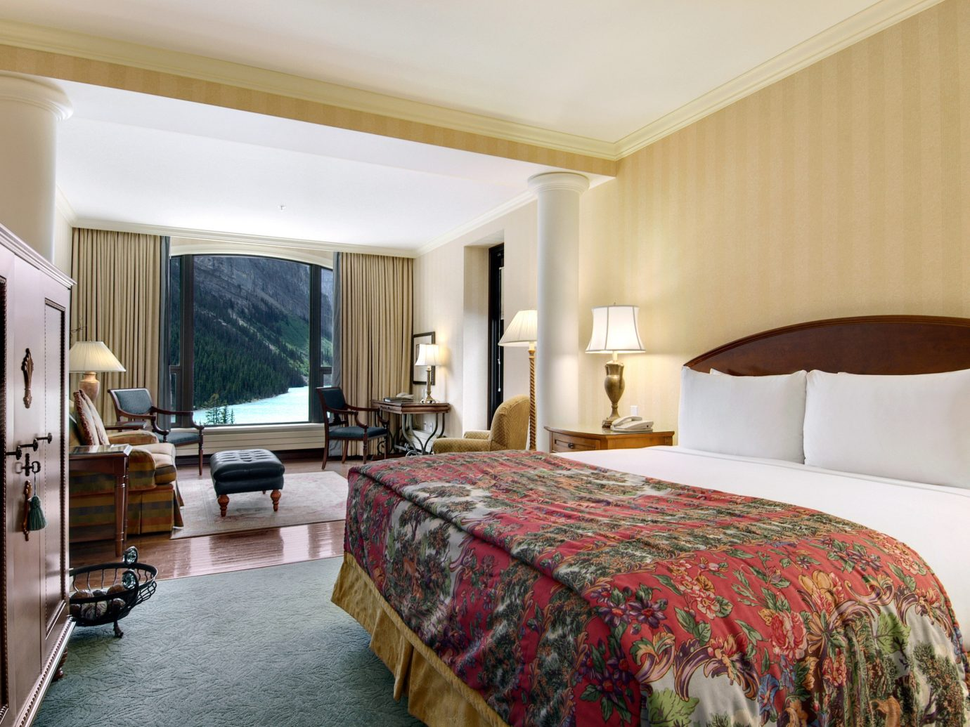 Alberta Boutique Hotels Canada Hotels indoor bed wall sofa room Bedroom floor ceiling window hotel property Suite estate real estate interior design furniture Resort cottage Villa pillow apartment decorated containing