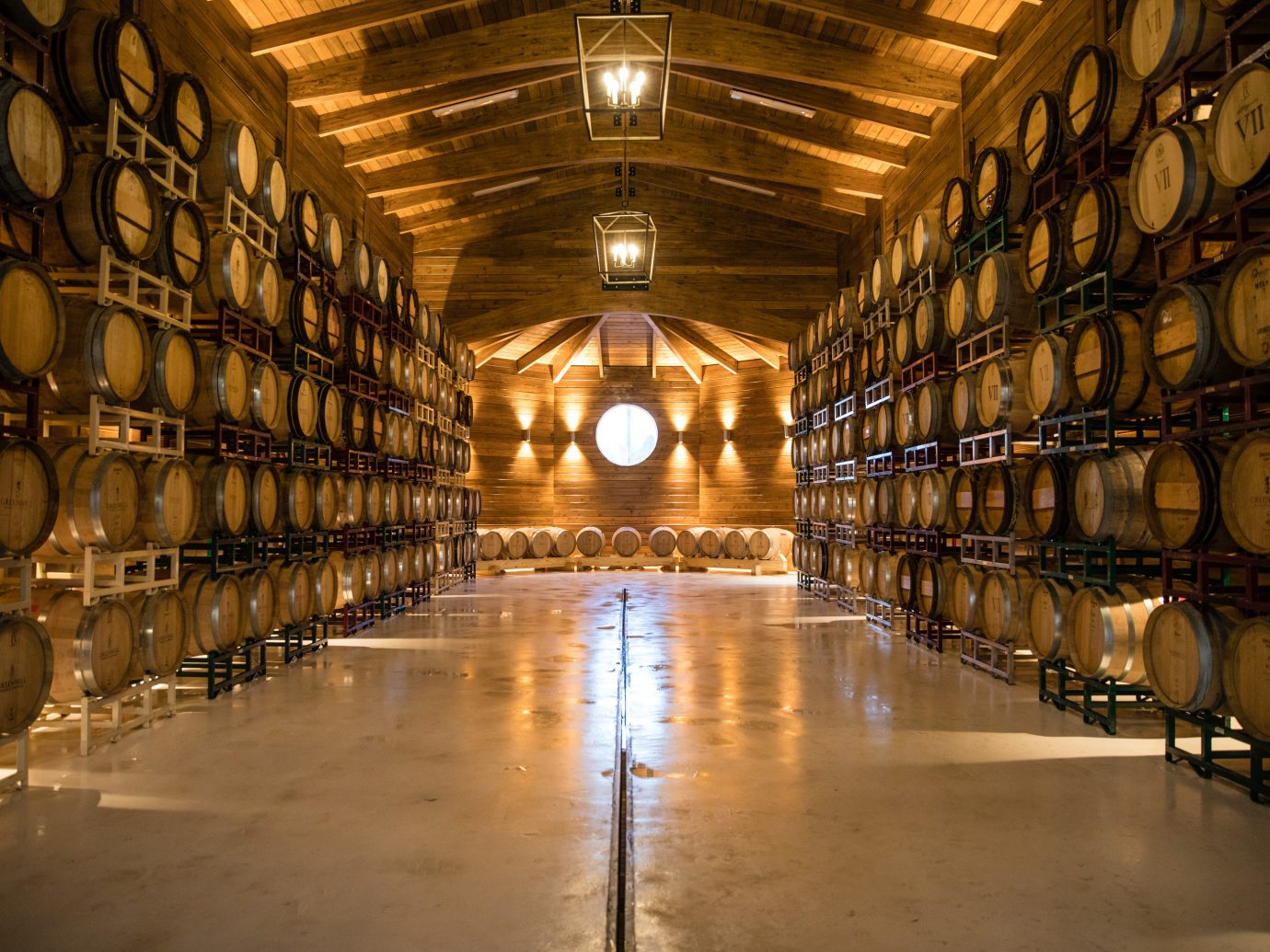 Romance Trip Ideas Weekend Getaways indoor ceiling Winery wine cellar tourist attraction warehouse lots basement long aisle symmetry several lined