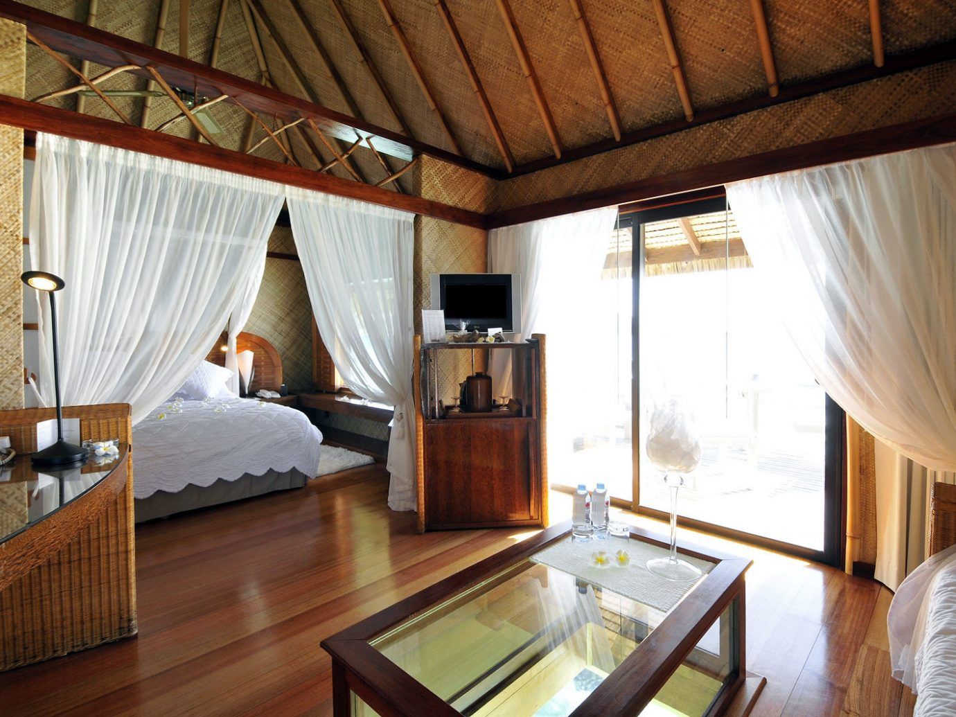 Bedroom Hotels Living Suite indoor floor room property ceiling estate cottage Resort Villa interior design real estate farmhouse furniture