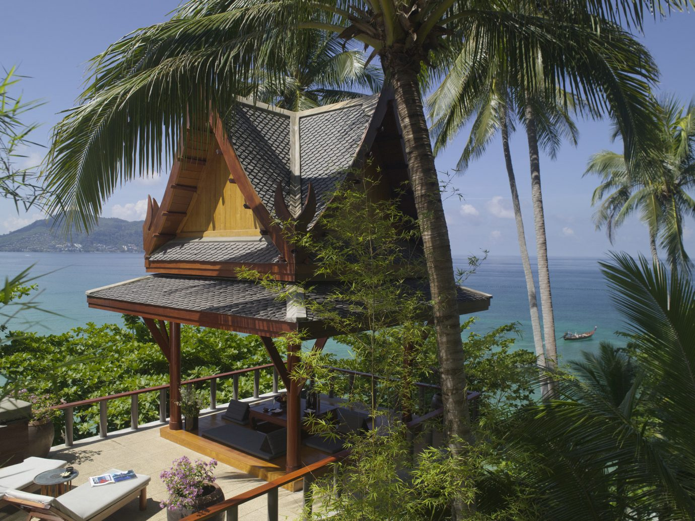 Hotels tree outdoor sky plant property Resort vacation arecales palm tropics Beach Jungle estate Villa caribbean palm family lined shade