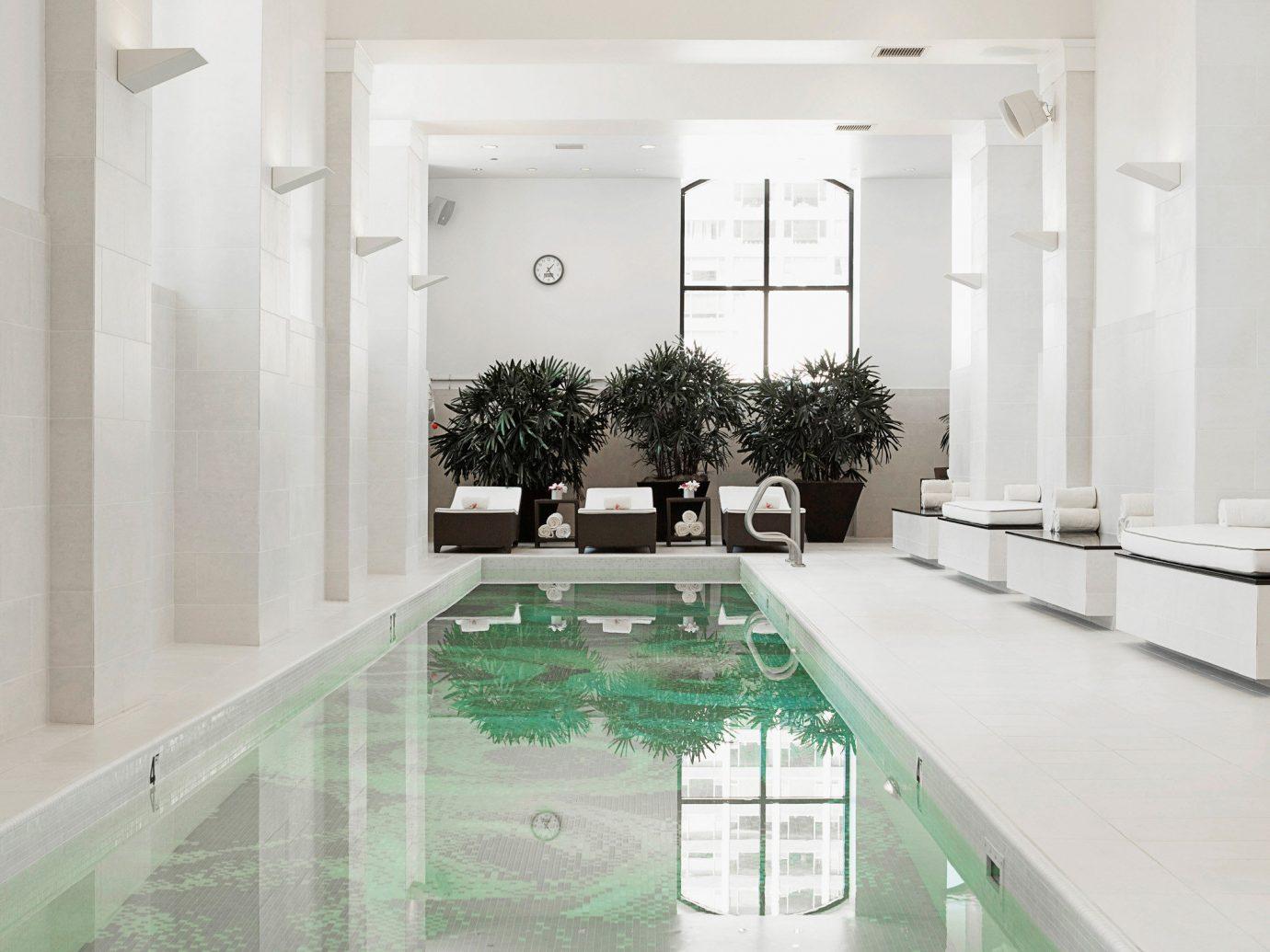 Hotels floor property room indoor swimming pool bathtub interior design estate home flooring daylighting Design living room bathroom mansion area furniture