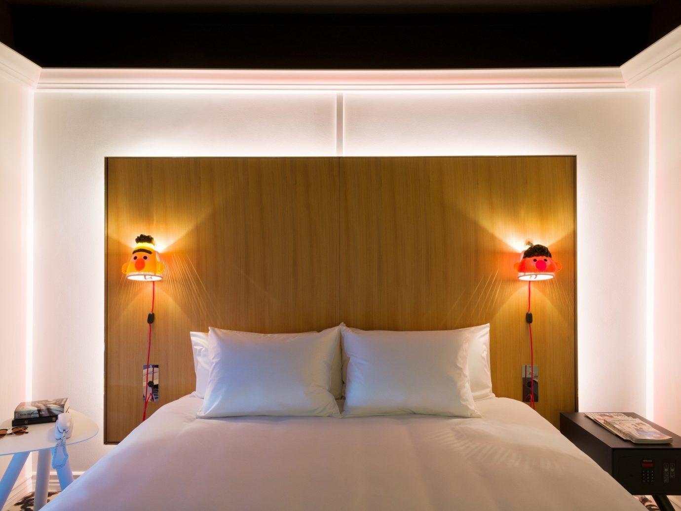 Food + Drink wall bed indoor room Bedroom Suite hotel interior design white Design furniture ceiling estate flat