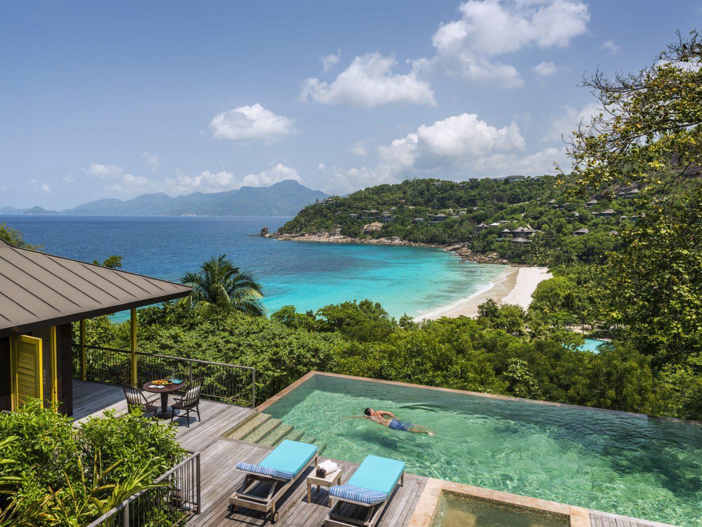 Hotels Trip Ideas tree sky outdoor property vacation swimming pool estate Resort Sea bay caribbean Villa Beach real estate Coast tropics overlooking shore day