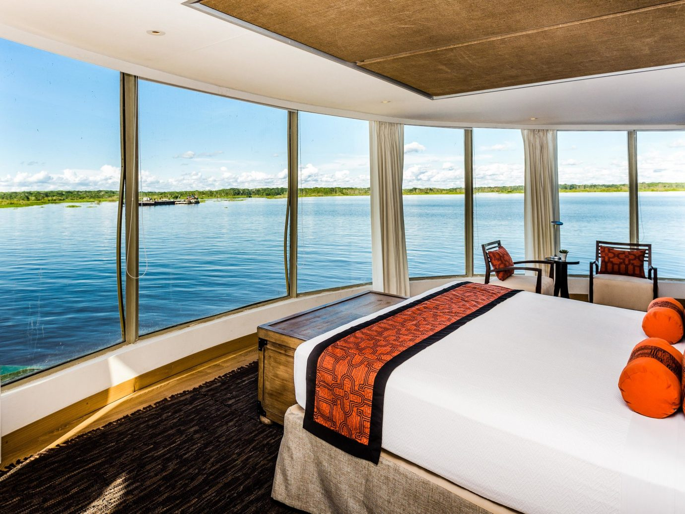 Cruise Travel Luxury Travel Outdoors + Adventure Trip Ideas indoor ceiling window water hotel floor property bed room real estate interior design estate home Suite condominium penthouse apartment wood Bedroom vacation apartment house Resort daylighting Villa furniture overlooking flat several