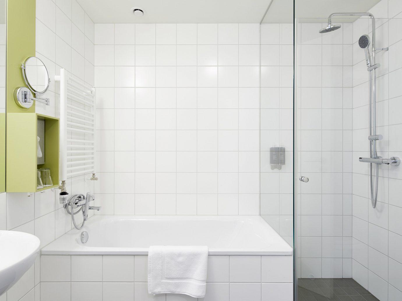 Boutique Hotels Hotels Iceland Reykjavík indoor bathroom wall room tile tap bathroom accessory plumbing fixture interior design bathroom cabinet floor product design bathroom sink toilet seat angle toilet product ceramic sink shower tiled