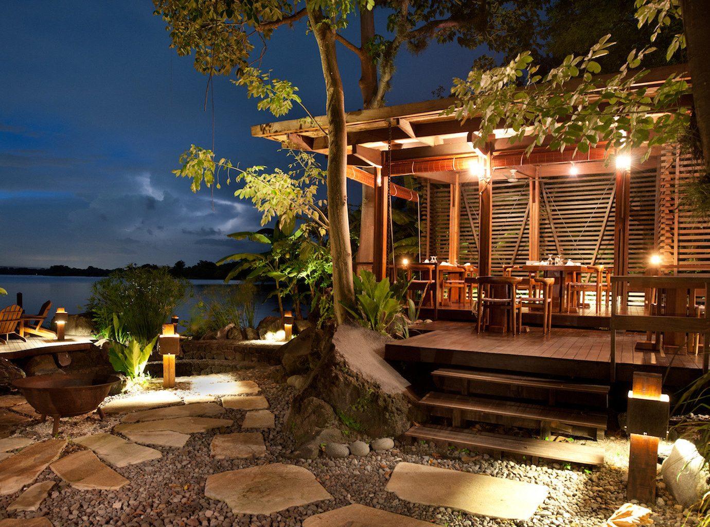 Jetsetter Guides tree outdoor house Resort estate home vacation backyard landscape lighting Villa mansion light restaurant Courtyard decorated Christmas
