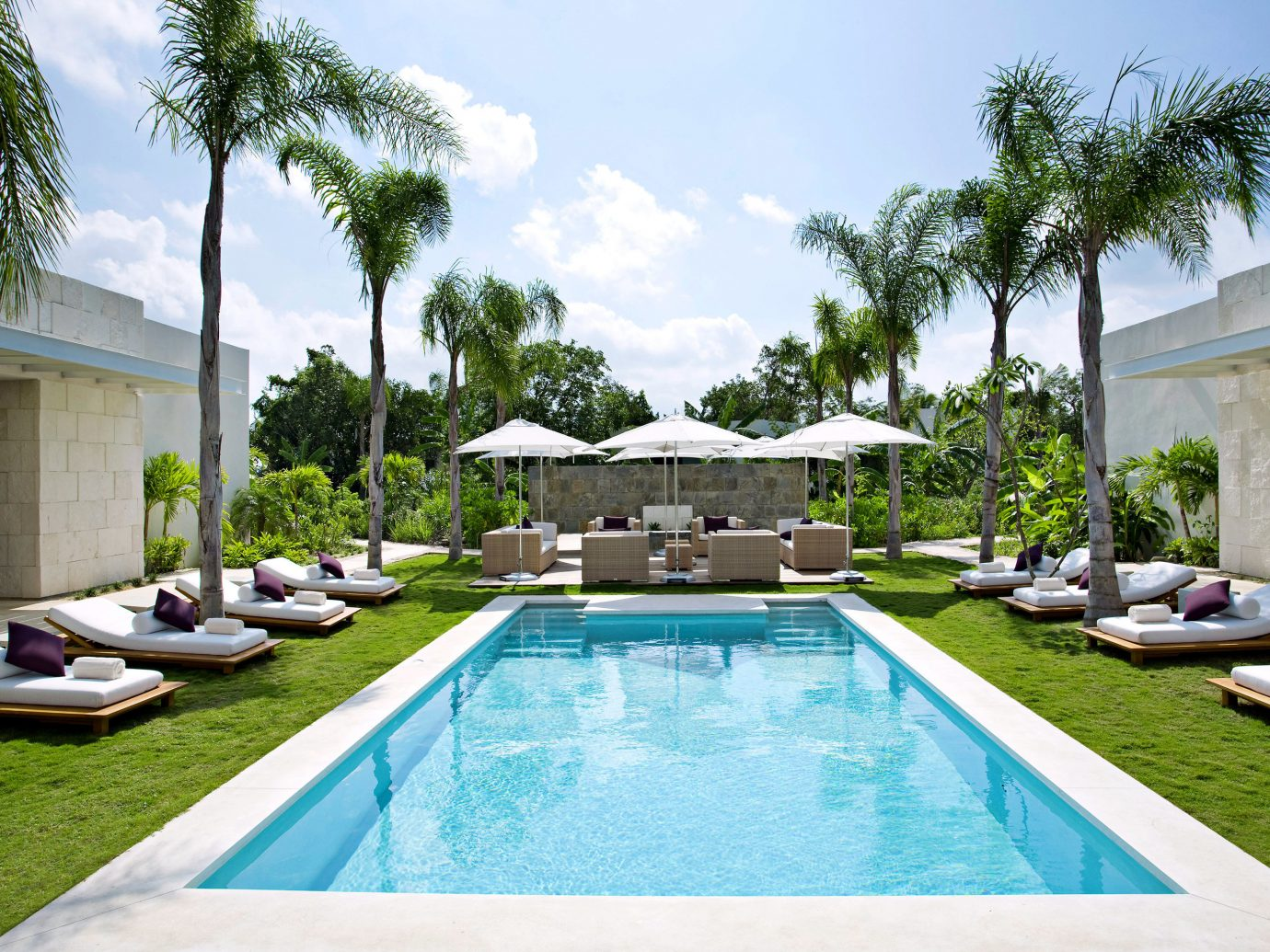 Adult-only All-inclusive Hotels Luxury Pool Trip Ideas Wellness sky outdoor tree grass swimming pool property Resort estate Villa lawn backyard condominium vacation home mansion real estate hacienda Courtyard area swimming