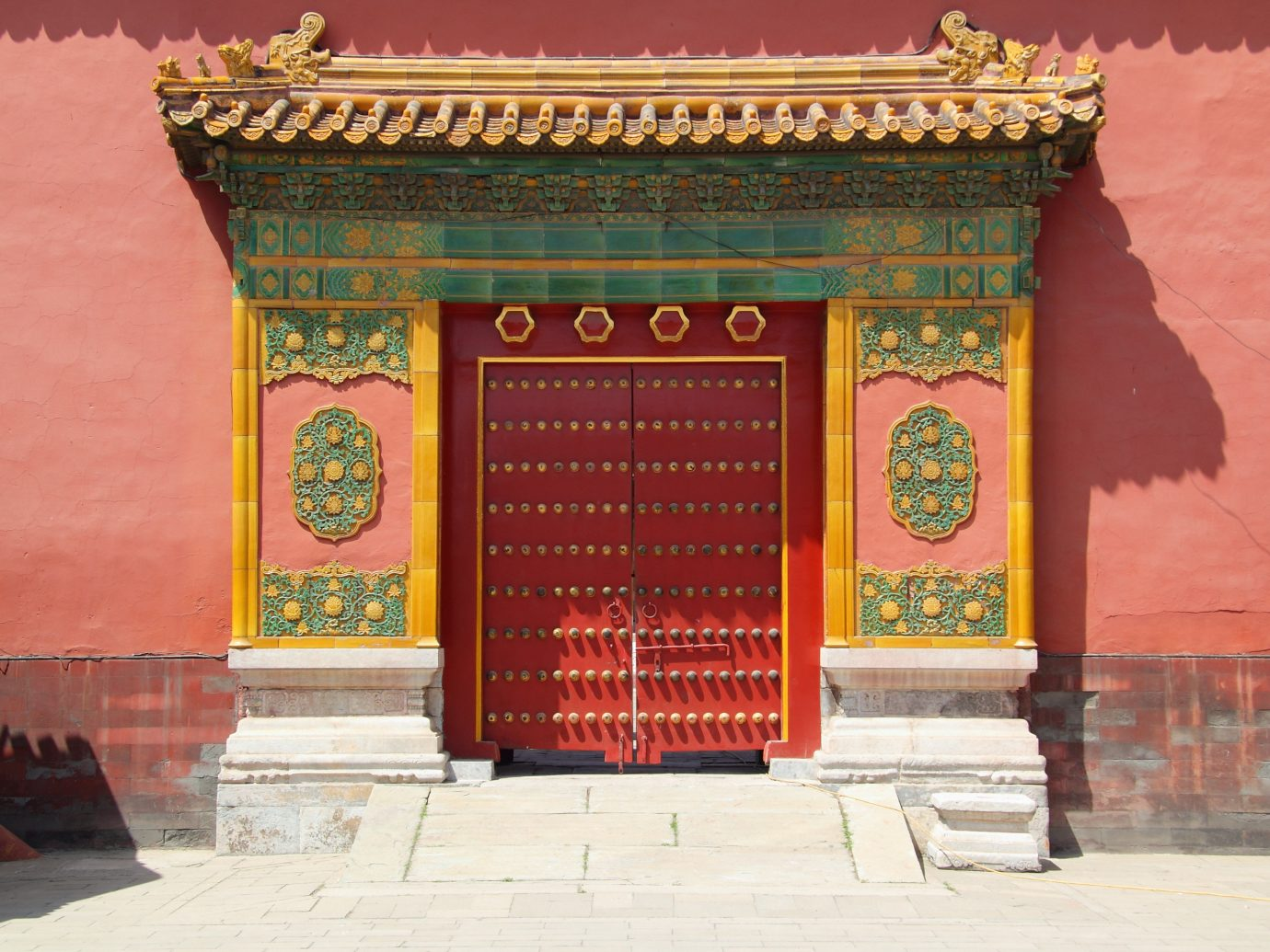 Offbeat outdoor building sidewalk place of worship hindu temple shrine temple palace colorful bright colored
