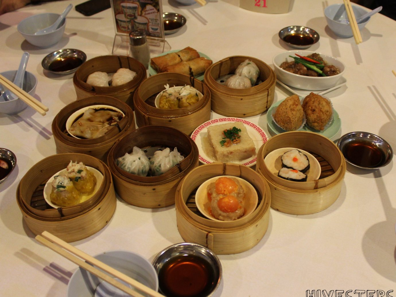 Jetsetter Guides table indoor plate food meal dessert chinese food lots cuisine dim sum asian food breakfast brunch different various baking buffet full set several variety
