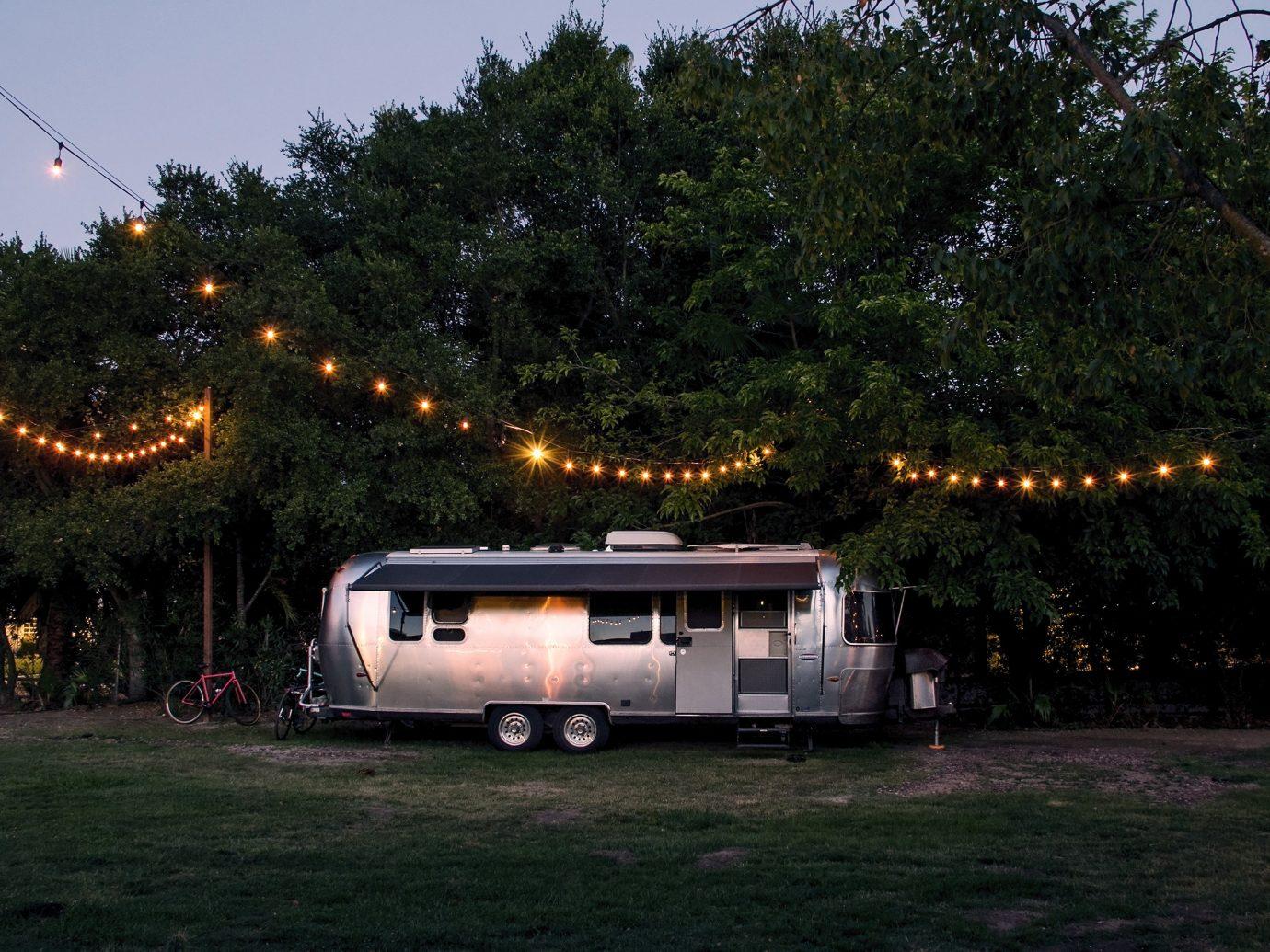 Trip Ideas tree outdoor grass sky night light atmosphere of earth vehicle lighting transport evening