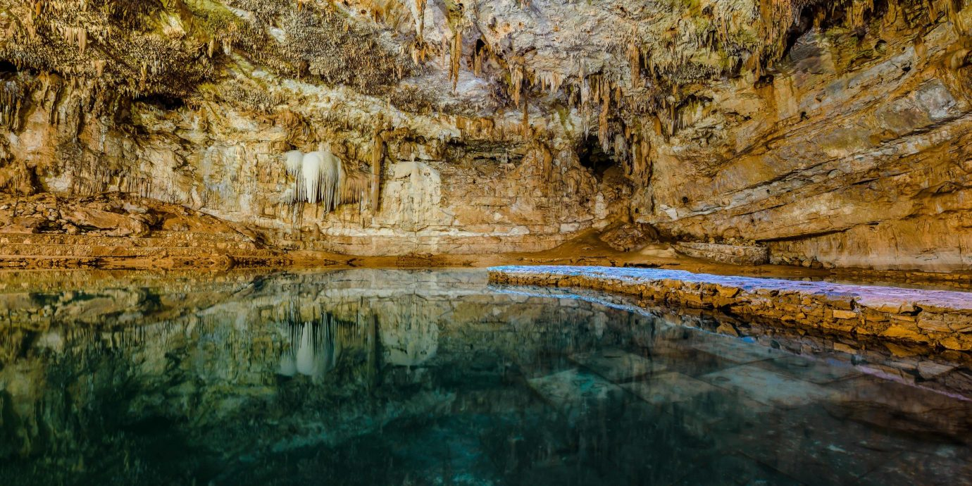 Trip Ideas grass water outdoor Nature reflection formation cave geology underground lake rock fluvial landforms of streams narrows escarpment watercourse outcrop mineral spring landscape sea cave cliff bedrock karst landforms wadi