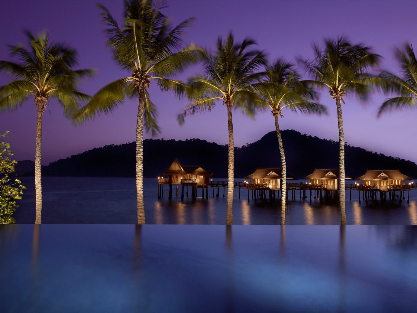 Hotels tree water palm outdoor reflection Beach night palm family arecales evening woody plant plant lighting dusk sunlight lined surrounded sandy shore