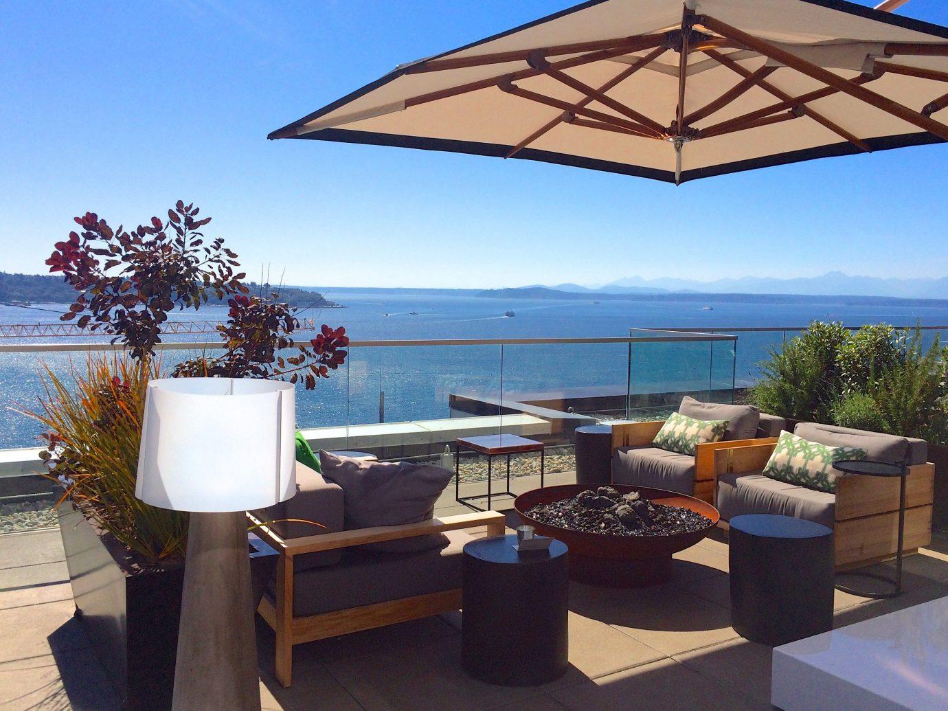 Food + Drink sky outdoor property building Villa estate Resort cottage real estate outdoor structure furniture several