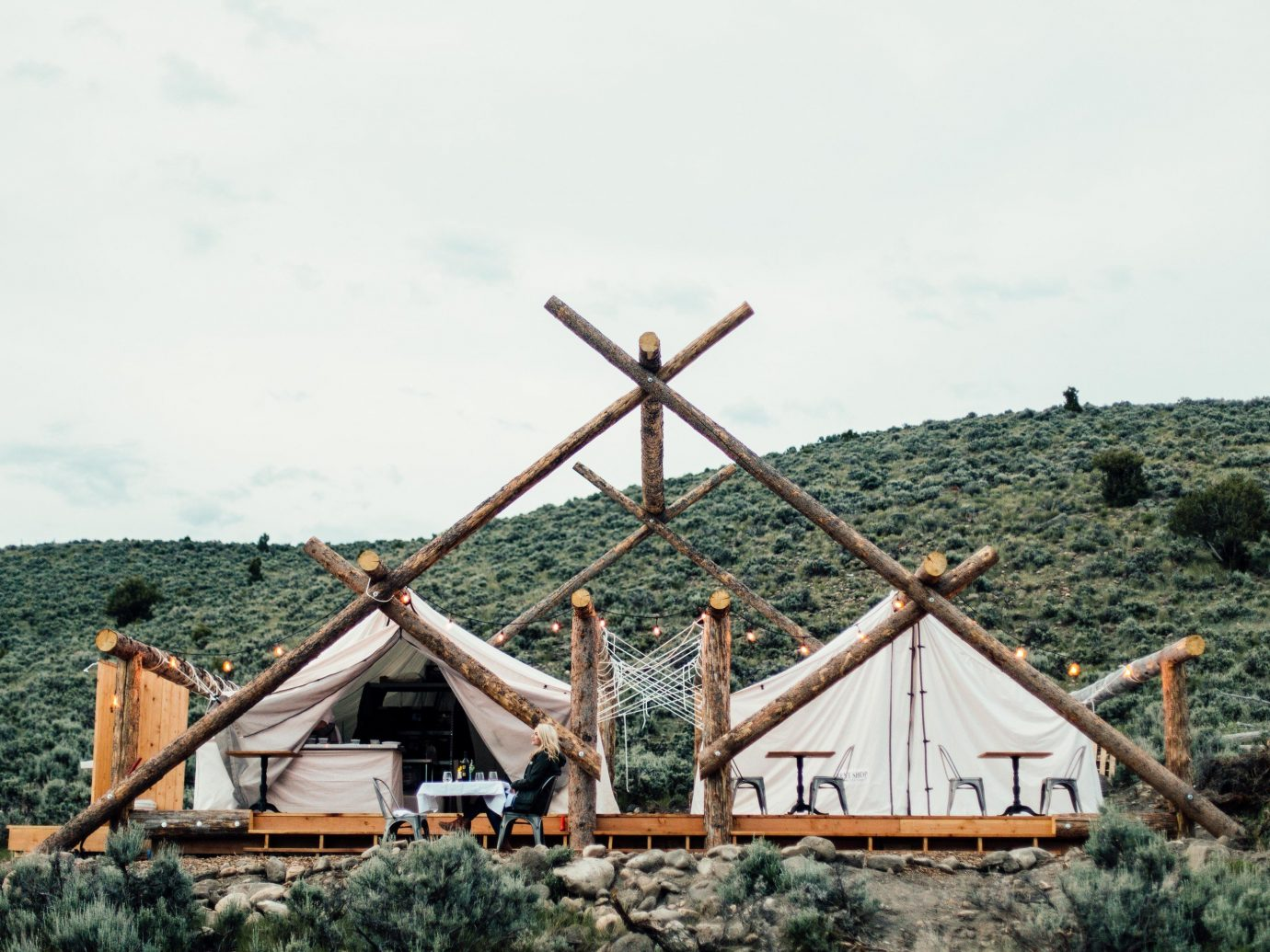 Glamping Luxury Travel Trip Ideas sky rural area roof tree house home outdoor structure windmill