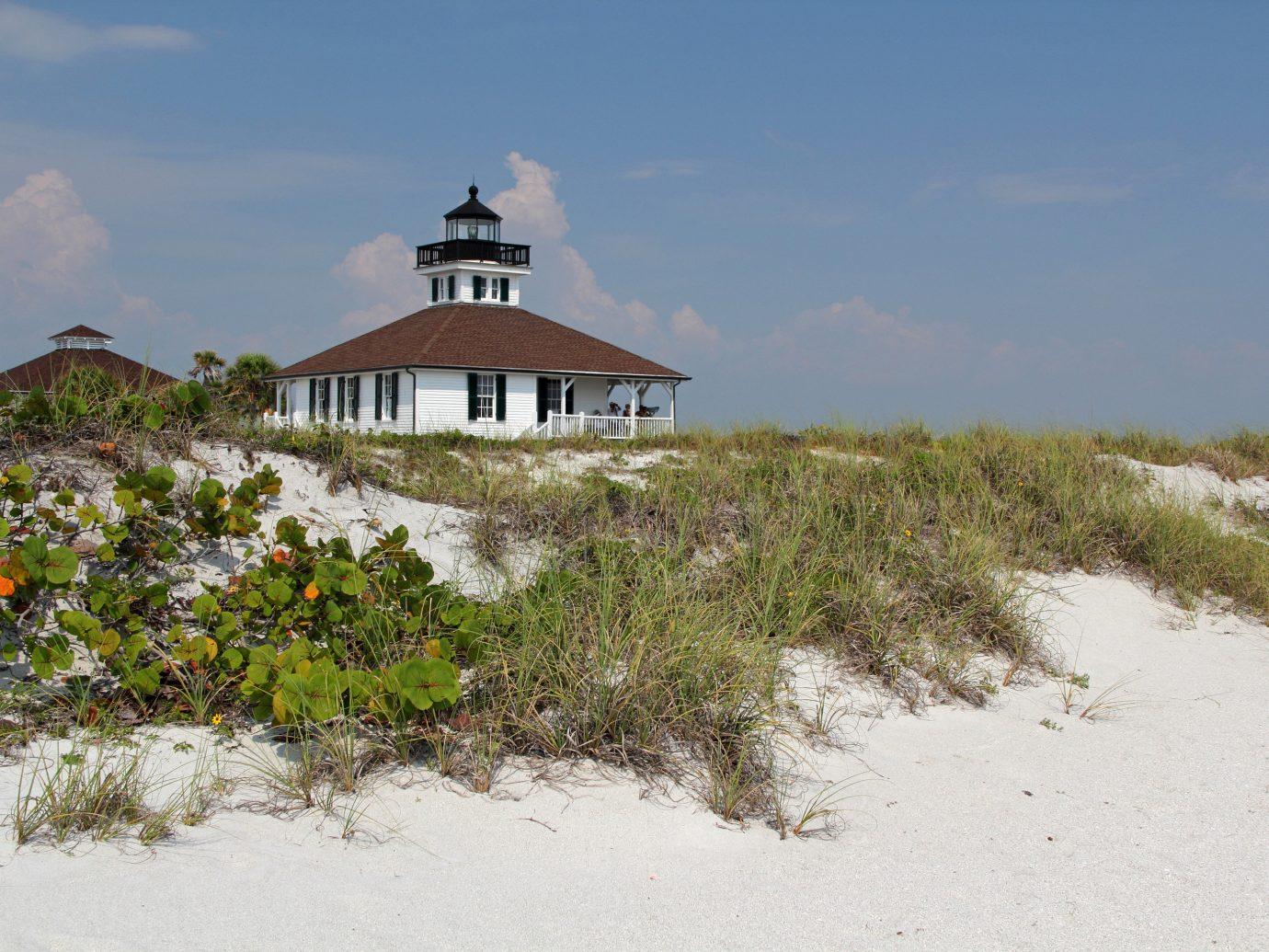 Trip Ideas outdoor Beach Coast Nature Sea shore tower rural area sand surrounded