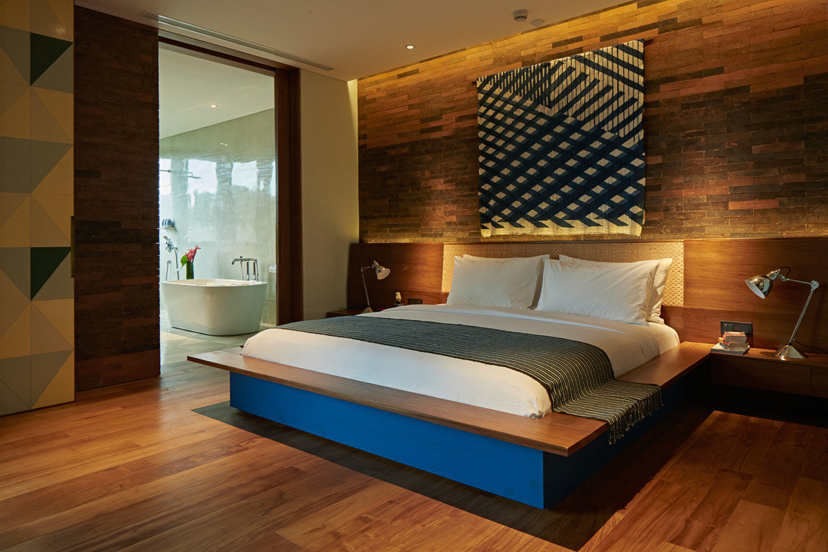 Health + Wellness Hotels floor indoor wall room Bedroom property ceiling hardwood interior design bed Suite estate wood flooring wood furniture bed frame hard Modern
