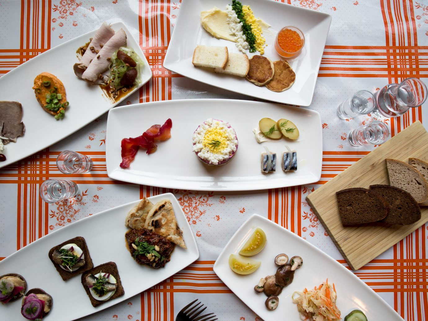 Food + Drink Style + Design Trip Ideas Weekend Getaways plate food dish meal lunch cuisine different items breakfast asian food produce baking meat several arranged