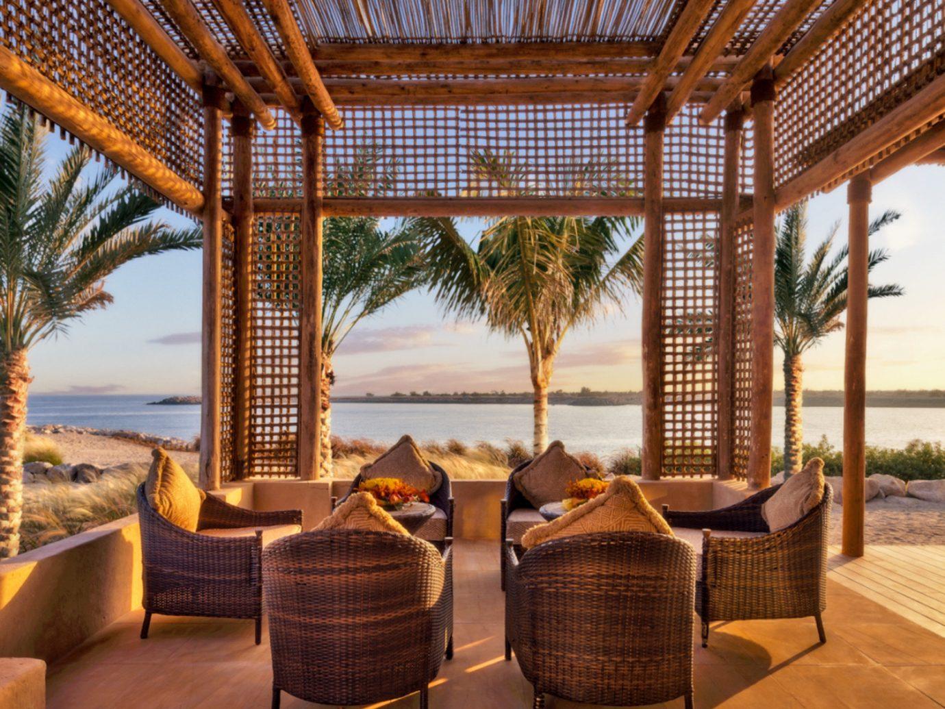 Beach Living Lounge Luxury Scenic views Secret Getaways Trip Ideas property chair Resort room estate outdoor structure Villa wood real estate interior design eco hotel cottage furniture