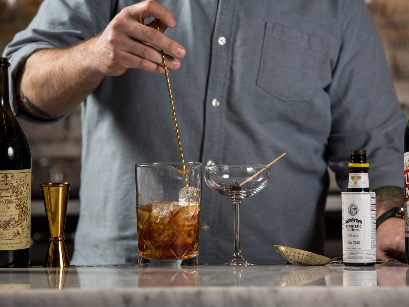 Food + Drink person wine Drink liqueur bottle man alcoholic beverage distilled beverage alcohol beer glass bottle whisky taste drinking