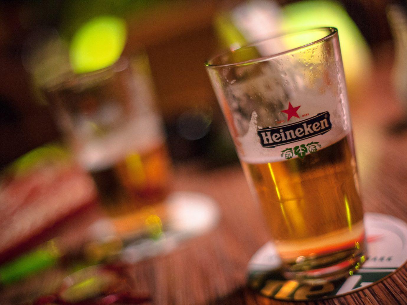 Travel Tips table food Drink cup indoor alcoholic beverage liqueur distilled beverage beer alcohol glass pint us cocktail beverage bottle meal