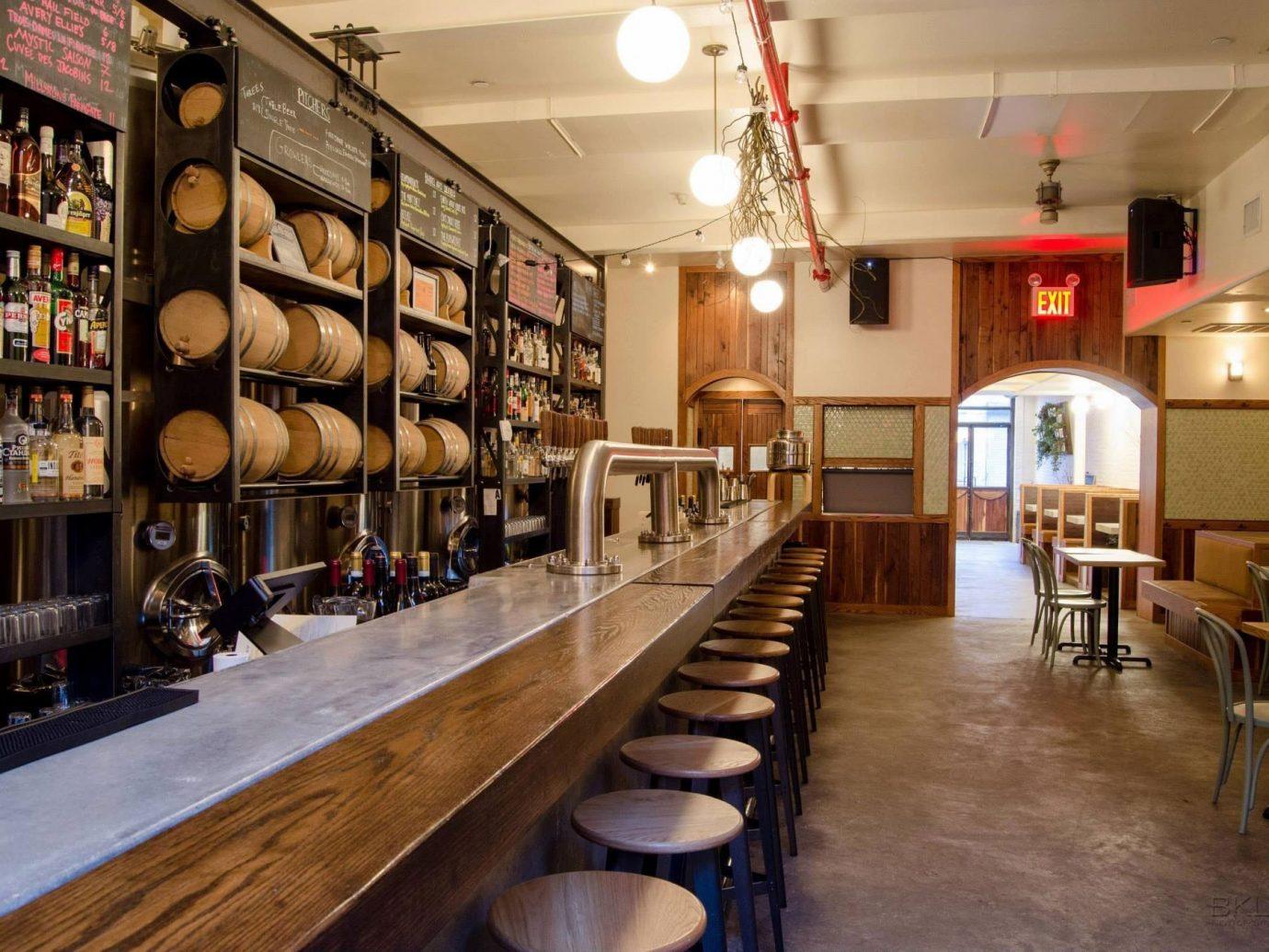 Food + Drink indoor floor Living room ceiling wood restaurant Bar café wooden interior design Dining furniture area dining room