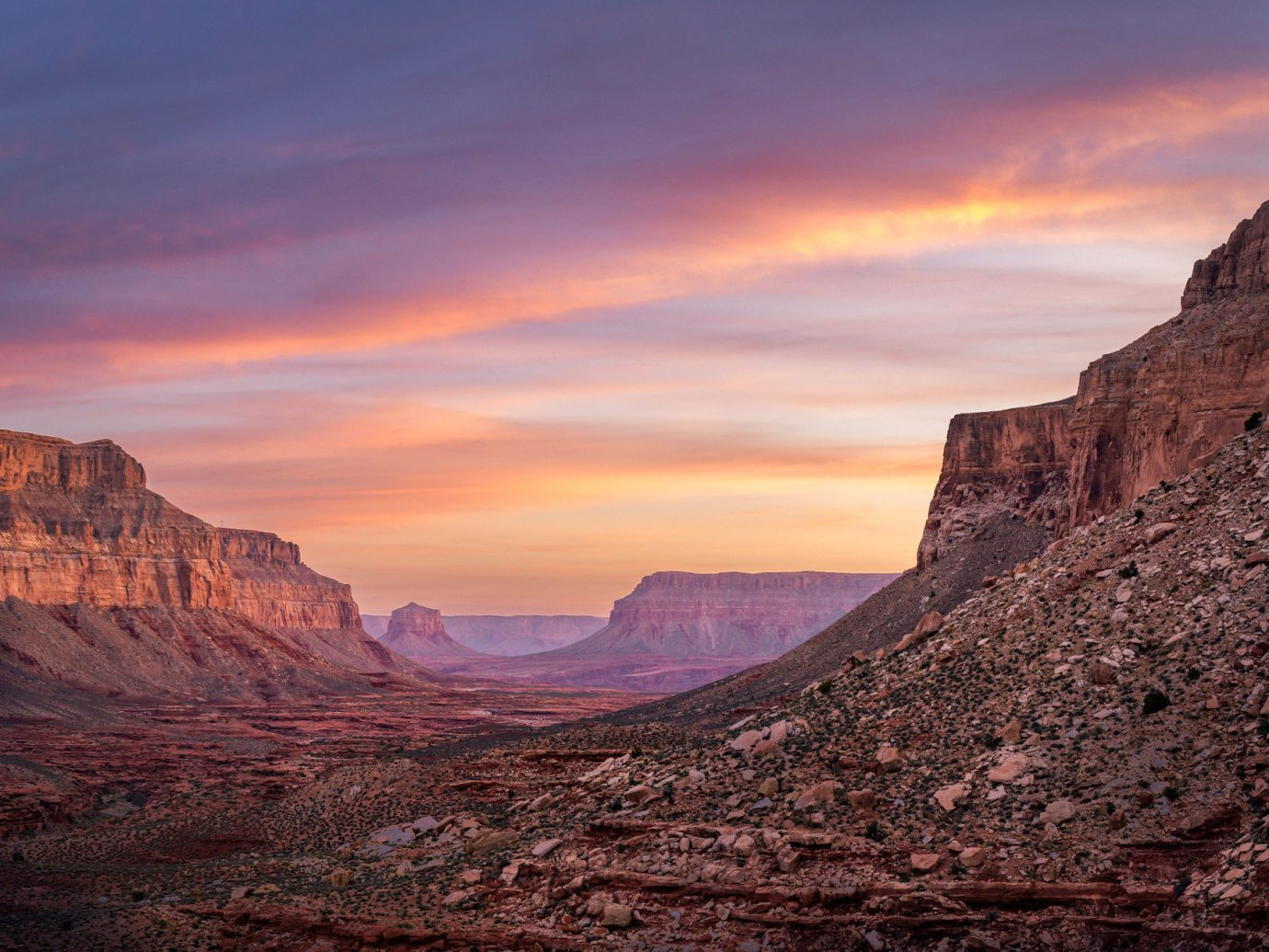 Family Travel National Parks Outdoors + Adventure Trip Ideas valley canyon mountain outdoor sky Nature mountainous landforms geographical feature landform butte Sunset sunrise badlands rock Desert dawn landscape wadi plateau cliff dusk terrain formation geology lone dry hillside