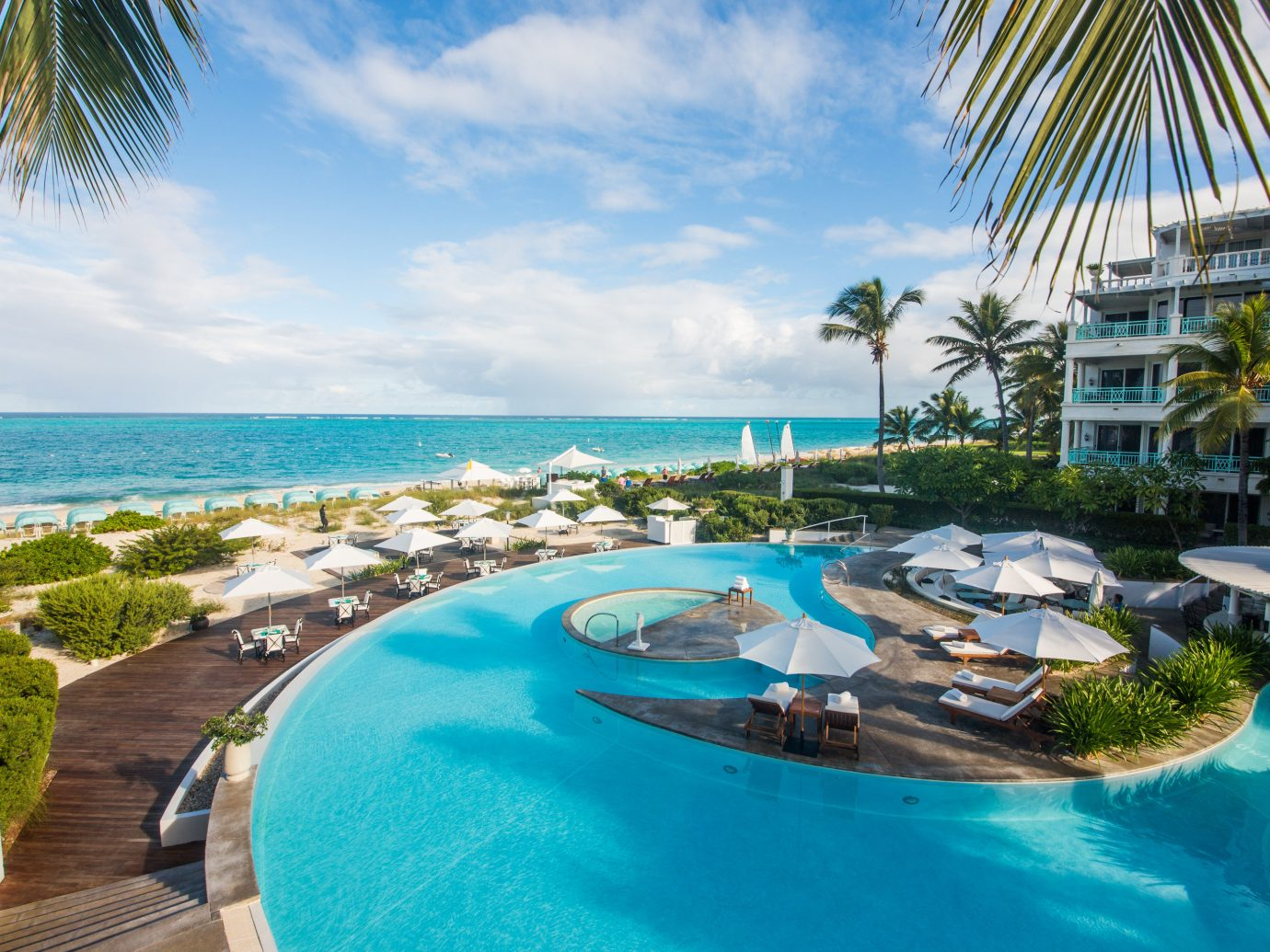 Hotels Romance Trip Ideas sky water outdoor Resort swimming pool leisure caribbean property vacation condominium estate reef resort town Water park Nature Pool Lagoon Sea Beach bay real estate lawn blue overlooking plant shore