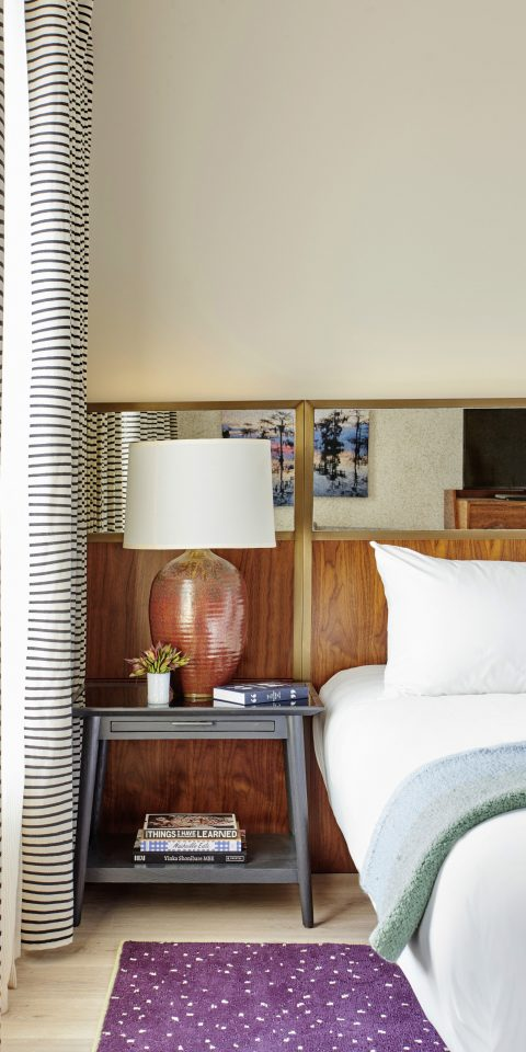 Boutique Hotels Trip Ideas indoor wall room property living room bed floor interior design home condominium pillow white estate green wood Suite furniture Design real estate window covering cottage flooring ceiling apartment Bedroom