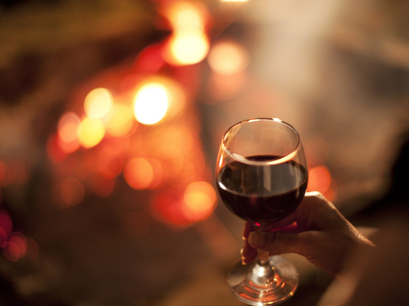 Health + Wellness Hotels Spa Retreats person indoor color red light alcoholic beverage Drink darkness night wine macro photography lighting wine glass blur