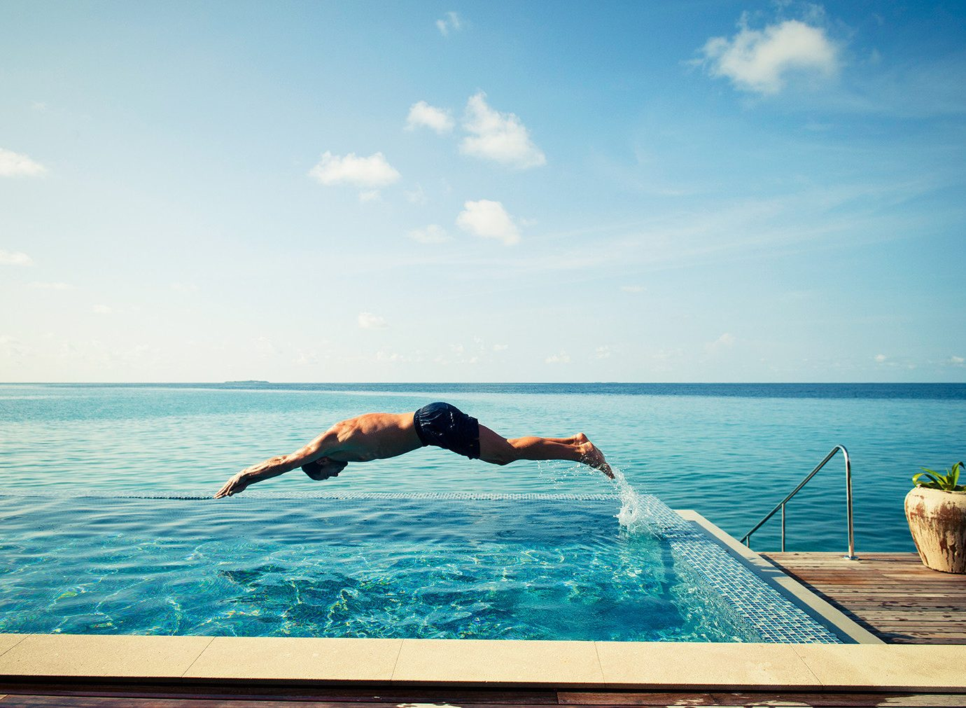 Luxury Travel Trip Ideas water sky outdoor leisure Sea swimming pool water sport Ocean vacation physical fitness sunlight swimming shore