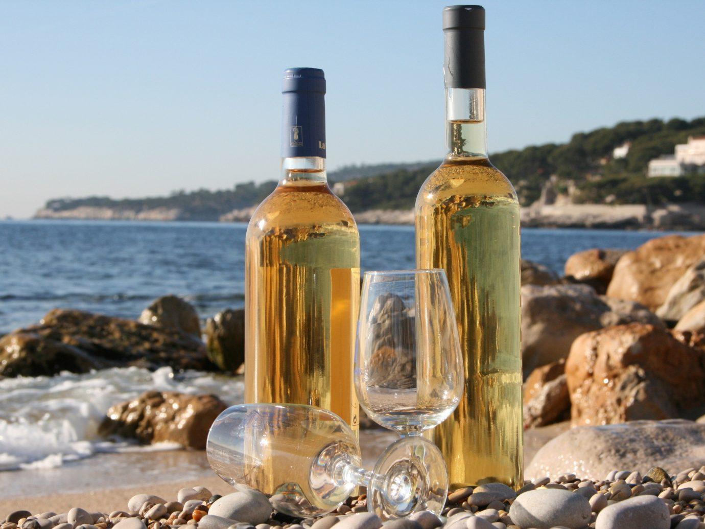 Road Trips Trip Ideas sky outdoor water alcoholic beverage distilled beverage Drink glass bottle wine bottle liqueur alcohol