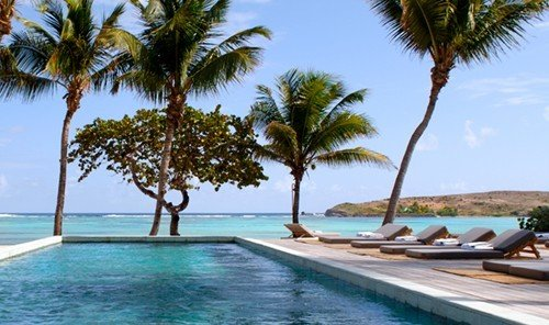 Trip Ideas tree sky water palm outdoor Resort Beach caribbean property vacation swimming pool lined arecales Lagoon plant bay Villa resort town estate Island Pool Sea shore swimming sandy