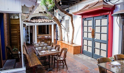 Jetsetter Guides property chair room restaurant cottage Resort Dining home estate real estate Villa interior design porch farmhouse furniture