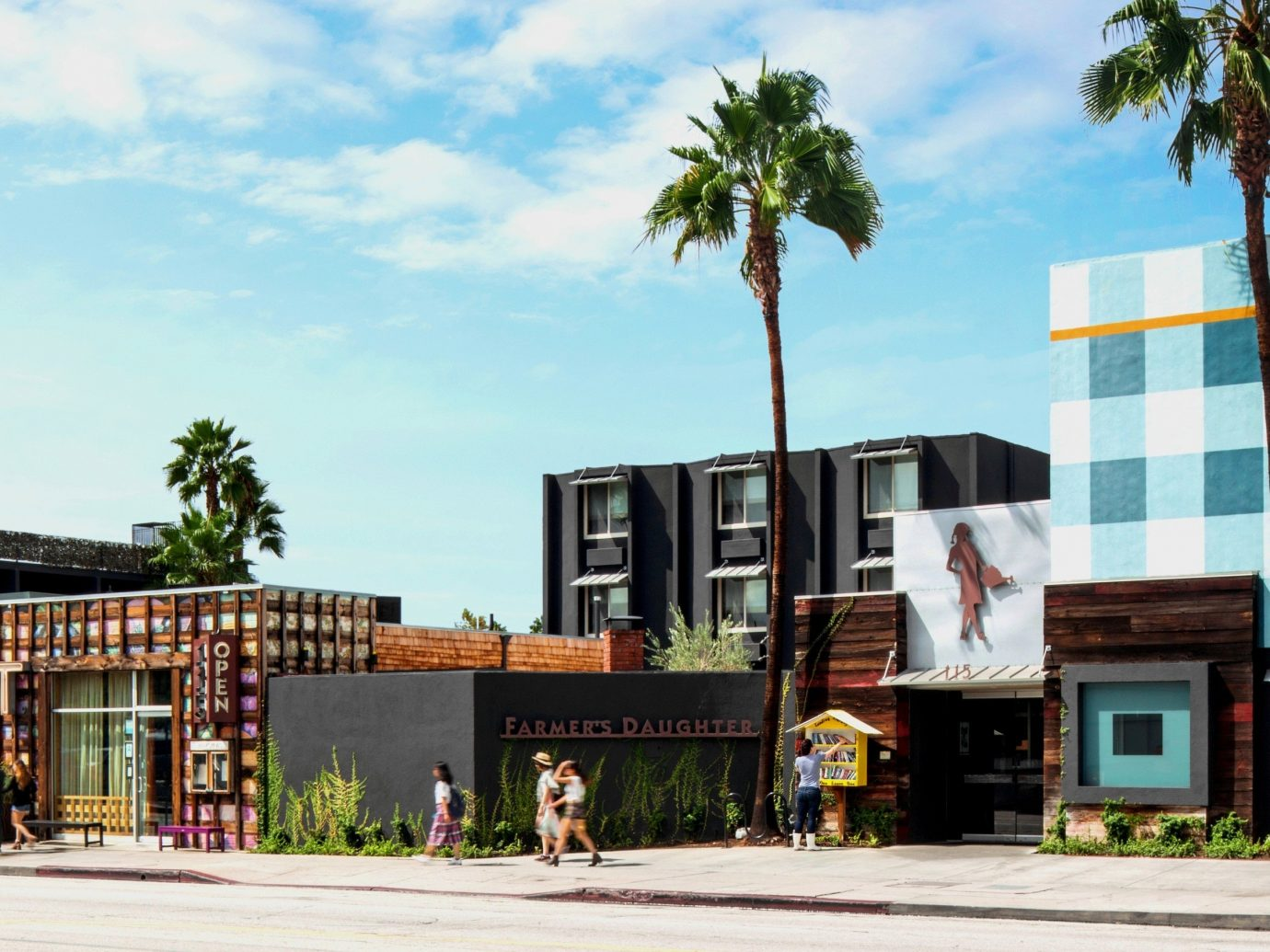 Hotels Style + Design Trip Ideas outdoor sky building tree road mixed use neighbourhood Architecture residential area palm tree real estate arecales home City Downtown facade house condominium commercial building palm plant past