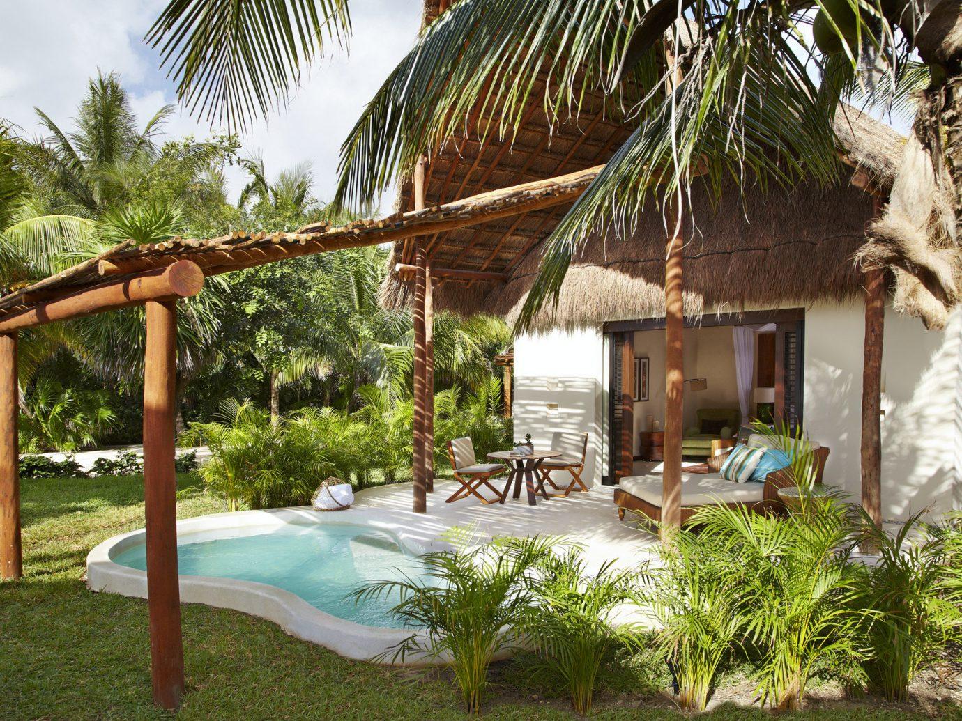 Beauty Hotels Trip Ideas tree outdoor property Resort vacation plant estate Villa Jungle backyard eco hotel hacienda area cottage lawn outdoor structure palm shade furniture Garden