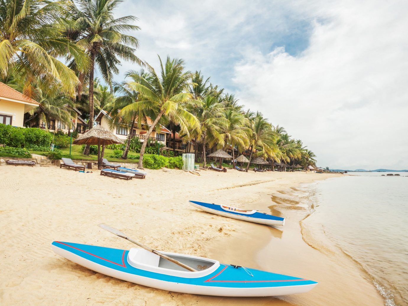 Secret Getaways Trip Ideas outdoor Beach sky surfing tree ground water sand body of water Sea vehicle vacation shore surfboard surfing equipment and supplies caribbean Boat Nature Coast bay tropics boating boarding paddle sandy palm lined