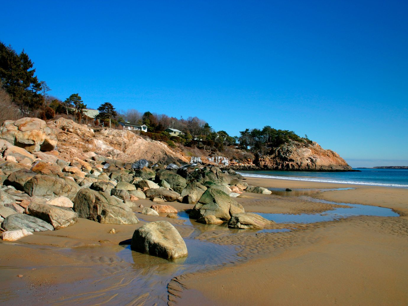 sky water outdoor Nature Beach shore Sea body of water Coast natural environment Ocean vacation sand rock bay landscape cape material cove wave