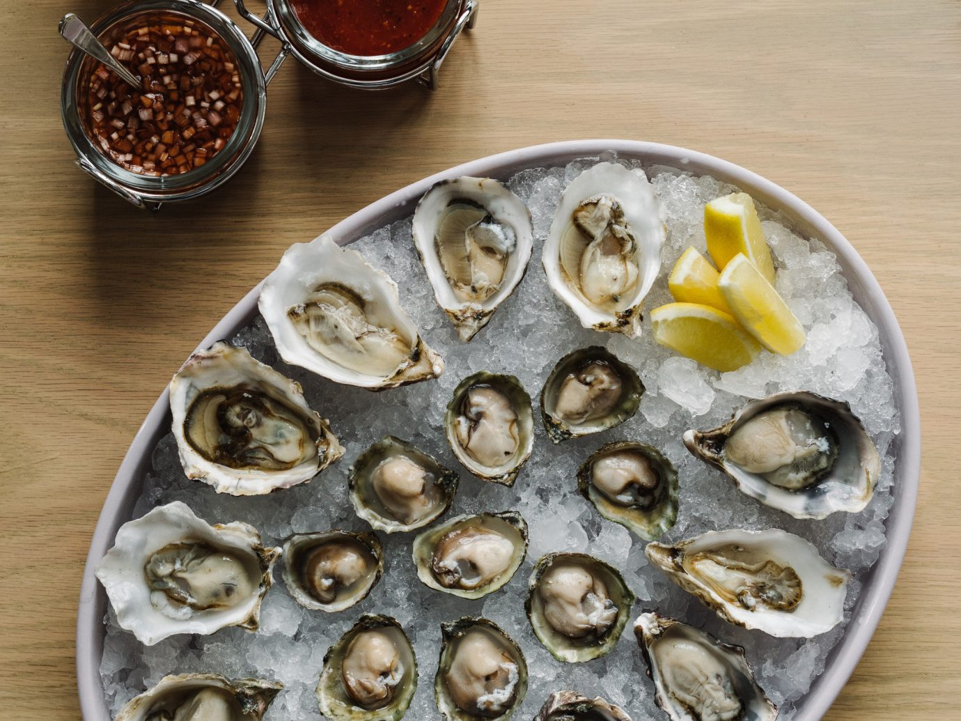 Trip Ideas Weekend Getaways table plate food dish Seafood fish produce wooden mussel clams oysters mussels and scallops meal animal source foods