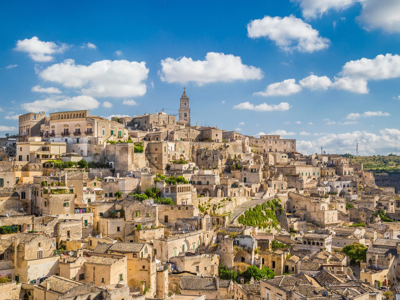 Jetsetter Guides sky building outdoor Town geographical feature historic site landmark cityscape human settlement City neighbourhood residential area ancient history Village canyon landscape Ruins ancient rome Coast panorama aerial photography unesco world heritage site
