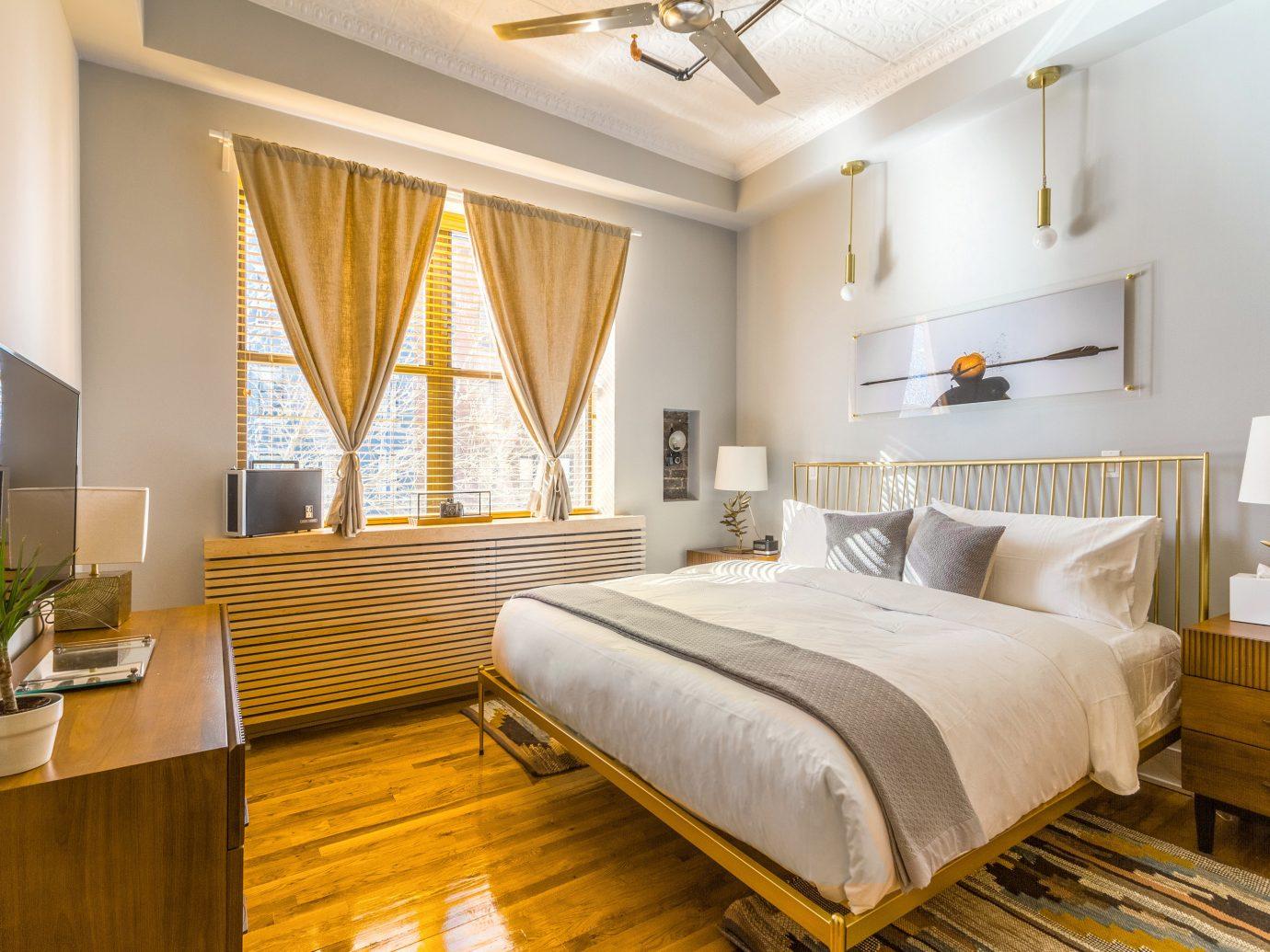 Hotels indoor wall floor bed room property Bedroom estate Suite real estate home interior design hotel living room hardwood cottage condominium