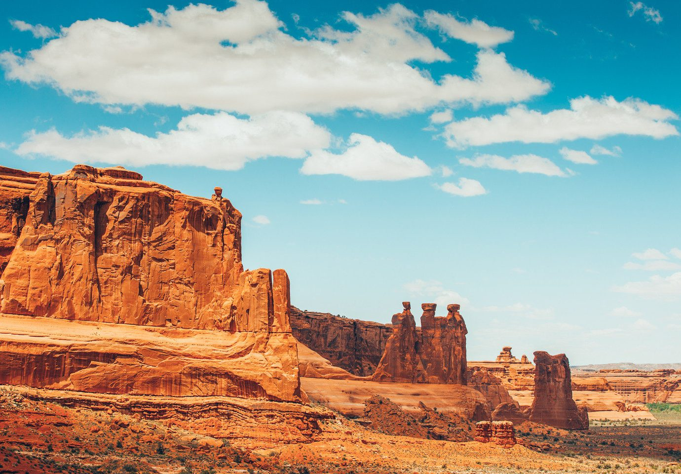 National Parks Outdoors + Adventure Trip Ideas valley canyon sky outdoor Nature butte landform geographical feature rock badlands landscape arch cliff plateau formation wadi terrain geology