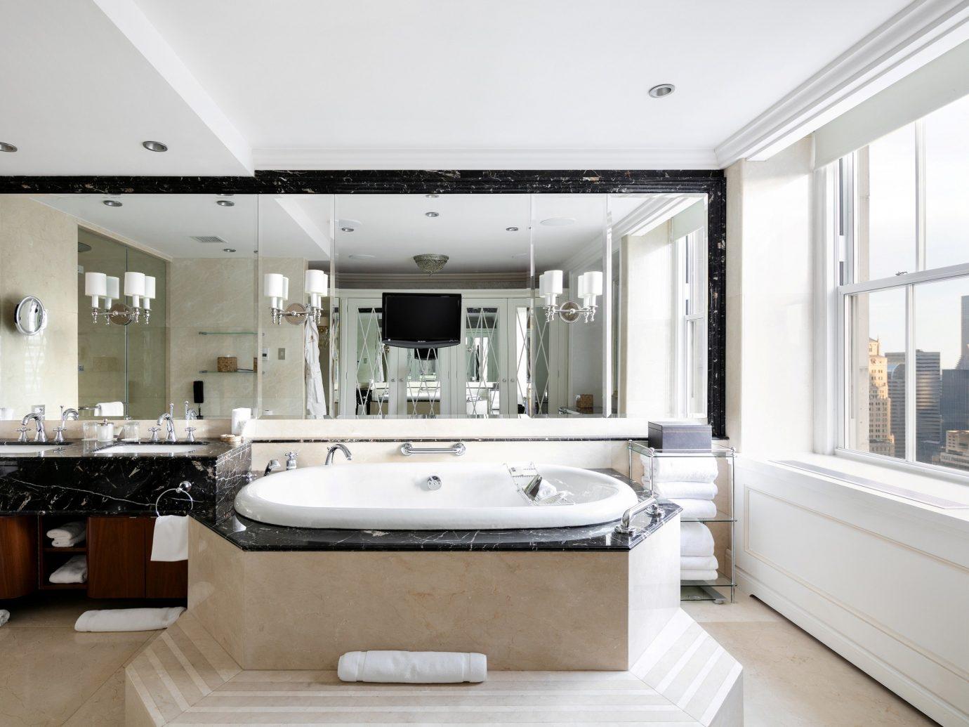 Hotels Luxury Travel indoor bathroom wall floor ceiling mirror window sink property room interior design estate tub bathtub home Suite plumbing fixture interior designer big toilet Bath Modern tile tiled