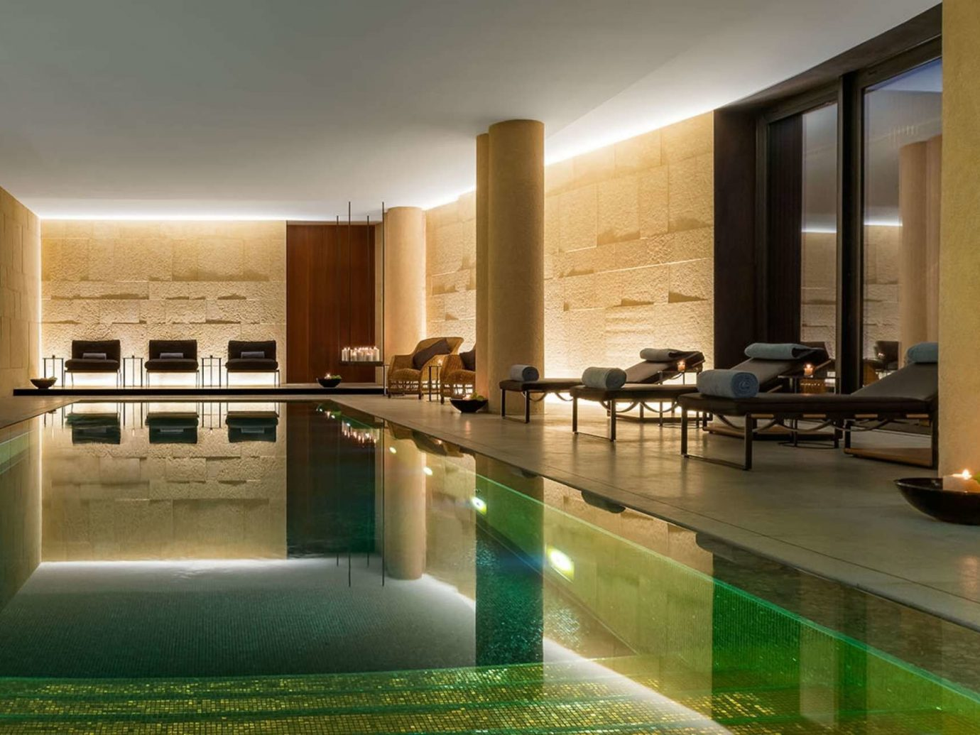 ambient lighting chic dim Health + Wellness Hotels indoor pool interior lights lounge chairs Luxury moody private relaxation Spa Spa Retreats wall indoor property swimming pool room estate Architecture condominium floor Lobby interior design lighting real estate professional Design mansion Villa area