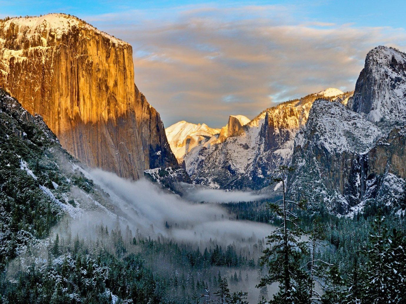 National Parks Outdoors + Adventure Trip Ideas outdoor Nature sky mountainous landforms landform geographical feature wilderness mountain water rock Winter reflection snow mountain range landscape cliff water feature terrain ice formation geology national park