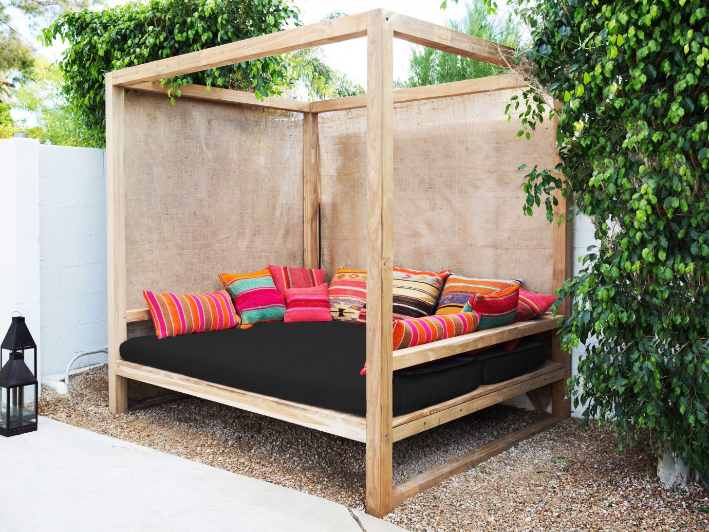 Hotels tree ground outdoor furniture bed cottage outdoor structure backyard bed frame studio couch outdoor play equipment stone